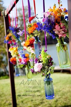 coachella theme cakes | Hanging florals in color tinted bottles are just lovely! Florals by ...