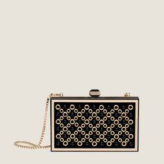 Small Abat-Jour clutch with metal stripes and studs on leather base with removable chain