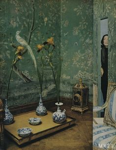 """Pauline de Rothschild.  Diana Vreeland's blood-red living room was rightly called a """"garden in hell,"""" her distant cousin Pauline de Rothschild's salon vert—wrapped in a panorama of hand-painted eighteenth-century wallpaper—is its inverse, an oasis of calm (left). A consummate tastemaker and a perfectionist, Rothschild was as fond of nature inside as out: Her renown tablescapes were created, she said, """"to give the impression of imaginary woods.""""  Photo by Horst P. Horst.  Vogue, June 1, 1969."""