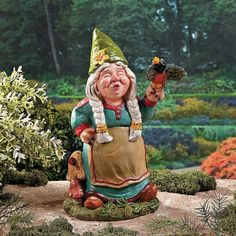 Bursting Out In Song, This Girl Gnome Has A Songbird Perched On Her Hand.  Add This Singing Girl Gnome To Your Garden For A Fun And Charming .