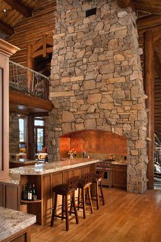 Love the rock work around/over oven. Talk about your open kitchen plan - this is awesome!