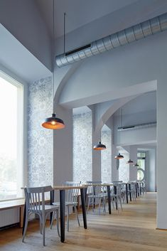<p>Nejen Bistro is located in a growing Prague district of Karlín which was affected by the hundred-year flooding in 2002. This event is reflected in the interior of the bistro, and thus the walls str