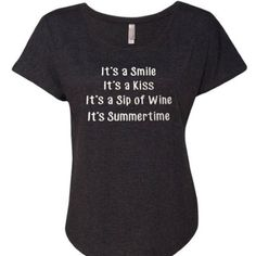 "Glitter It's Summertime Kenny Chesney Shirt This chic style tri-blend dolman shirt is designed to drape perfectly and accentuate a woman's figure. It has a very soft and flowy design. It is heather black. The glitter design on the shirt measures approx 7 3/4"" wide X 5"" tall. The words ""It's a Smile It's a Kiss It's a Sip of Wine It's Summertime"" are in silver glittter. Perfect for a country concert! A'Dena Accents Tops"