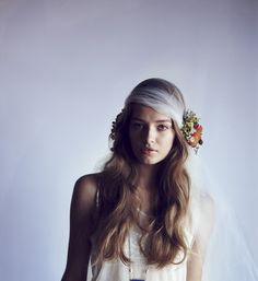 bohemian bride in floral hair crown with large silk flower | OneWed.com