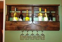 Wine rack made from a pallet just stained it and added an old rake for wine glasses as a holder