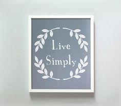 One of my favorite items hanging in my living room.   Live Simply print by Gus & Lula