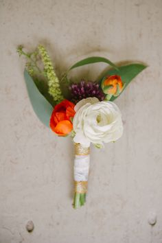 ranunculus boutonniere // photo by Catherine Guidry // http://ruffledblog.com/southern-charm-wedding-ideas