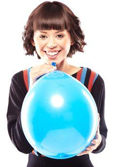 Cute woman blowing up blue party balloon Blue Balloons, Latex Balloons, Custom Balloons, Blue Party, Cute Woman, Still Image, Rough Cut, Presentation, Stock Photos