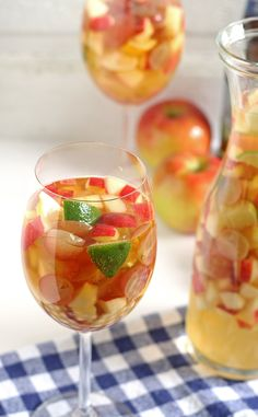 White wine apple cider sangria is the perfect addition to fall brunches. Grab your ingredients and try this recipe today! #cocktailhour