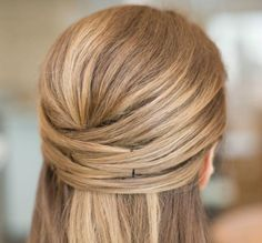 Use bobby pins to DIY this half-up 'do.
