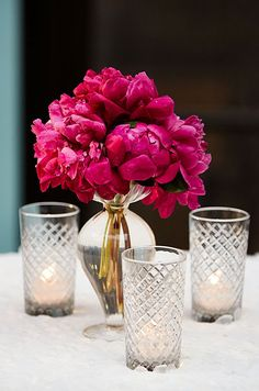 This glamorous display of peonies surrounded by candlelight is absolutely captivating.