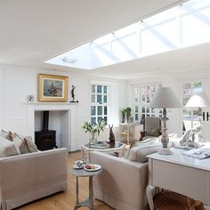 White living room with skylight, wood flooring, neutral sofas and neutral sculptural lamp Kitchen Living, Home Living Room, Living Room Designs, Living Area, Living Room Inspiration, Interior Design Inspiration, Design Ideas, Shabby, 25 Beautiful Homes