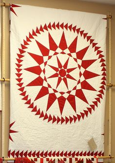 red and white star with flying geese