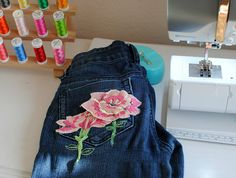 Our friends at Trash to Couture are in on this year's trend of custom patches and embroidery! Along with our Sulky Soft n Sheer Stabilizer, Sulky Rayon 40 wt. Thread and Sulky Fabri-Solvy Sheets, she was able to add a bit of glam to a pair of her favorite jeans! #DIY #refashion #recycle #embroidery #applique #custompatches #repurpose #sustainablefashion #newtrends