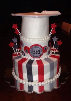Graduation cake.white grad cap. Stars & stripes. Red & grey.