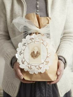 brown paper bag, paper doily, vintage photo and tied with tulle