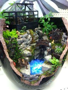 Broken pot fairy garden with water feature design by Kristin Middleton .