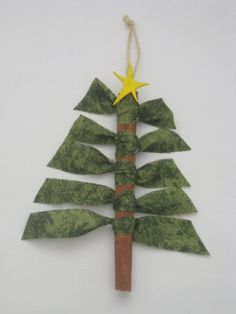 Cinnamon Stick Tree Ornaments-use a Popsicle stick and ribbon instead