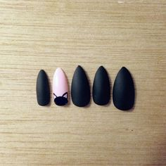 The perfect long sharp stiletto nails. A classic Matte Black, with an adorable kitten head peeping out from the half-moon of your accent nail!  The