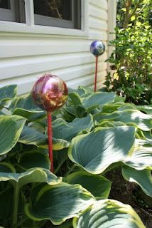 Make your own gazing balls for the garden - great gift and child craft idea.