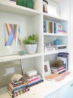 *Bookshelf styling... I like the idea of putting small plants in the shelves