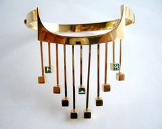 """Paula Häiväoja for Kaunis Koru (FI), vintage modernist gold cuff with a front fringe drop accented with square-cut greenish-blue tourmalines, Bronze Jewelry, Metal Jewelry, Vintage Jewelry, Fine Jewelry, Blue Tourmaline, Love Bracelets, Bracelet Designs, Modern Jewelry, Jewelry Necklaces"