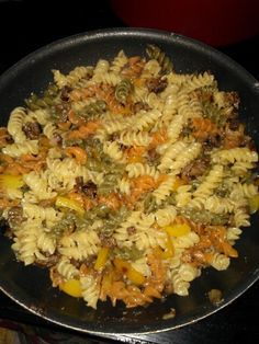A little EVOO onion and yellow peppers cooked with garlic salt and peper. Deglaze the pan with white wine.Add sausage or turkey sausage. While cooking this make your pasta of choice. When pasta is cooked and sausage is cooked add them together and cook on low to bring it together. Add parmesan cheese, mix, and add more seasonings to taste. YUM! Super easy!