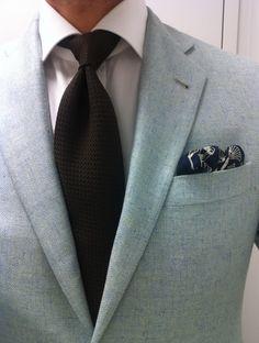 Ice blue herringbone jacket, brown grenadine tie, blue pants