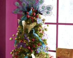 Decorating a one-of-a-kind tree with Global Gems ornaments #Christmas