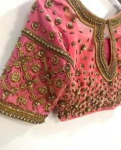 Stunning blush pink color designer blouse with floral design hand embroidery gold thread work and bead work. 01 February 2019