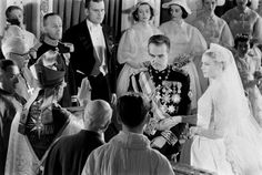 Grace Kelly and Prince Rainier join hands as the Bishop of Monaco administers the nuptial benediction at their wedding, Saint Nicholas Cathedral, April 1956. See more: http://ti.me/1KcLWrk  (Thomas D. McAvoy—The LIFE Picture Collection/Getty Images)