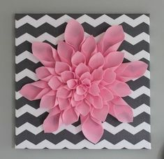 Pink flower on black and white zigzagged canvas