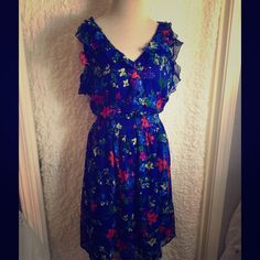 Dress Blue Perfect Sun dress. Adjusts to body but it's loose and comfortable at the same time. Formal or dressed down with jean jacket.  Elastic around waist and adorable sleeves.  It closes with two buttons in the back.   Worn only once for about 4hrs. Old Navy Dresses Midi