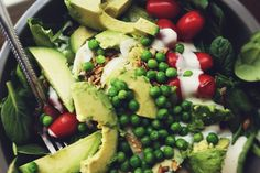 Blue Cheese and Peas Salad/ This salad is on a bed of spinach and butter lettuce. It has blue cheese dressing, avocados, tomatoes, sesame seeds and peas. (i LOVE peas!)