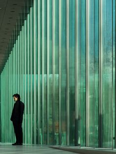 Kaan's new Supreme Court of the Netherlands features a facade of green glass lovres