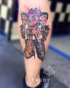 Sketch work tattoo on the calf of the robot of the Power Rangers.