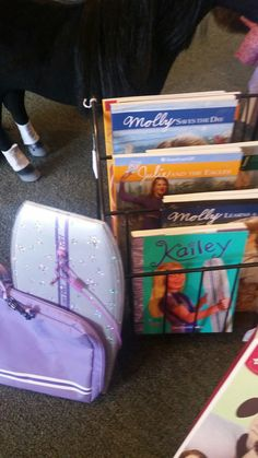 American Girl books &  AG  Kailey's surfboard. Booth 105.