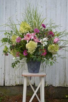 Stunning seasonal altar flowers..love grassy filler