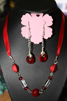 Red ribbon and coordinating beads. Beautiful to bling up your Christmas outfit.