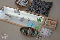 """MIrror play with stones, shells and rocks. Wonderful! I like the foil wrapped blocks too. A great way to make the """"old"""" new again."""