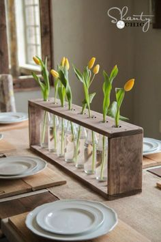 Place recycled glass soda bottles in a pine or whitewood frame and fill with fresh Mother's Day flowers for a breathtaking centerpiece she'll love.