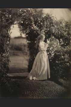 Victorian young woman in the garden about 1890's....