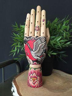 Wooden hand mannequin with drawing of a crane / door Inkspirednl