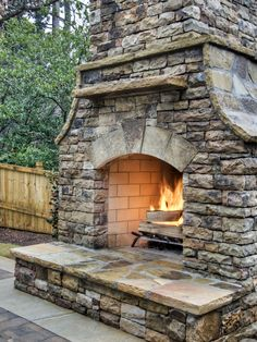 Lovely stone outdoor fireplace.