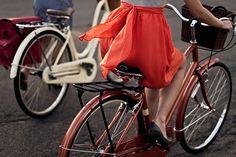 red skirt, red bike