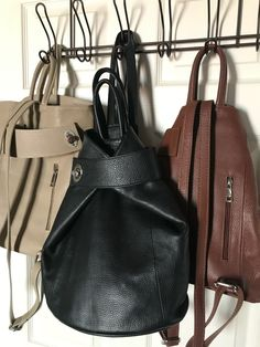 Which color do you like? Taupe, black or bown? Regardless of your choice, this bag is fabulous! It's stylish and functional. Zip closure with inside zip and slip wall pockets. Checkout all the ways to carry on our website. Available in several colors. #womensbackpack #womensleatherpurse #womensleatherpursesandwallets #orangehandbags #taupehandbags #backpackstyle #leathertote #fashion #pursesandbags Italian Leather Handbags, Leather Purses, Orange Handbag, Leather Backpack Purse, How To Make Handbags, Travel Tote, Stitching Leather, Wall Pockets, Purses And Bags