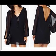 Nasty gal little black dress This dress is Preowned, worn once. It has v neck in a grind and deep v opening in a back. Sleeves have slit . Very elegant  dress Nasty Gal Dresses Mini