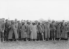 PRISONERS WAR ALBERT FRANCE 1918 (Q 10844)   A group of  German prisoners standing behind barbed wire in a Prisoners' Cage, near Albert. These prisoners were taken during the German Offensive.