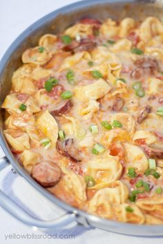 One Pot Meals: Tortellini & Sausage 1 lb package of Turkey Kielbasa 1/2 cup diced onion 20 oz. package of refrigerated Tortellini 20 oz can of whole tomatoes, cut in the can with kitchen scissors 1 cup chicken broth or water Pinch of salt & pepper 2 Tbsp cream cheese 2 cups shredded jack and cheddar cheeses