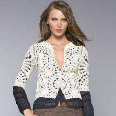 White jacket crochet. Openwork jacket with a pattern |